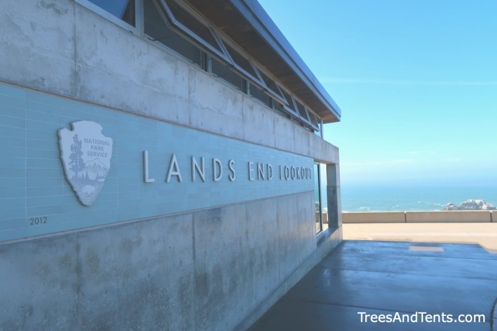 The sign on the building and a bit of the view from the Lands End Lookout and Visitors Center