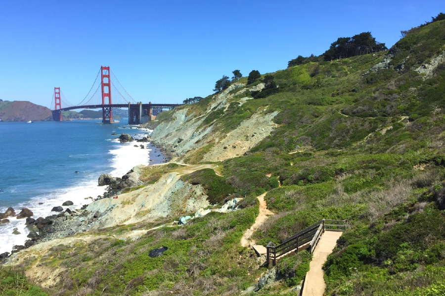 Hikers get amazing views of the Golden Gate Bridge as the Presidio's Batteries to Bluffs hiking trail winds along the bluffs.