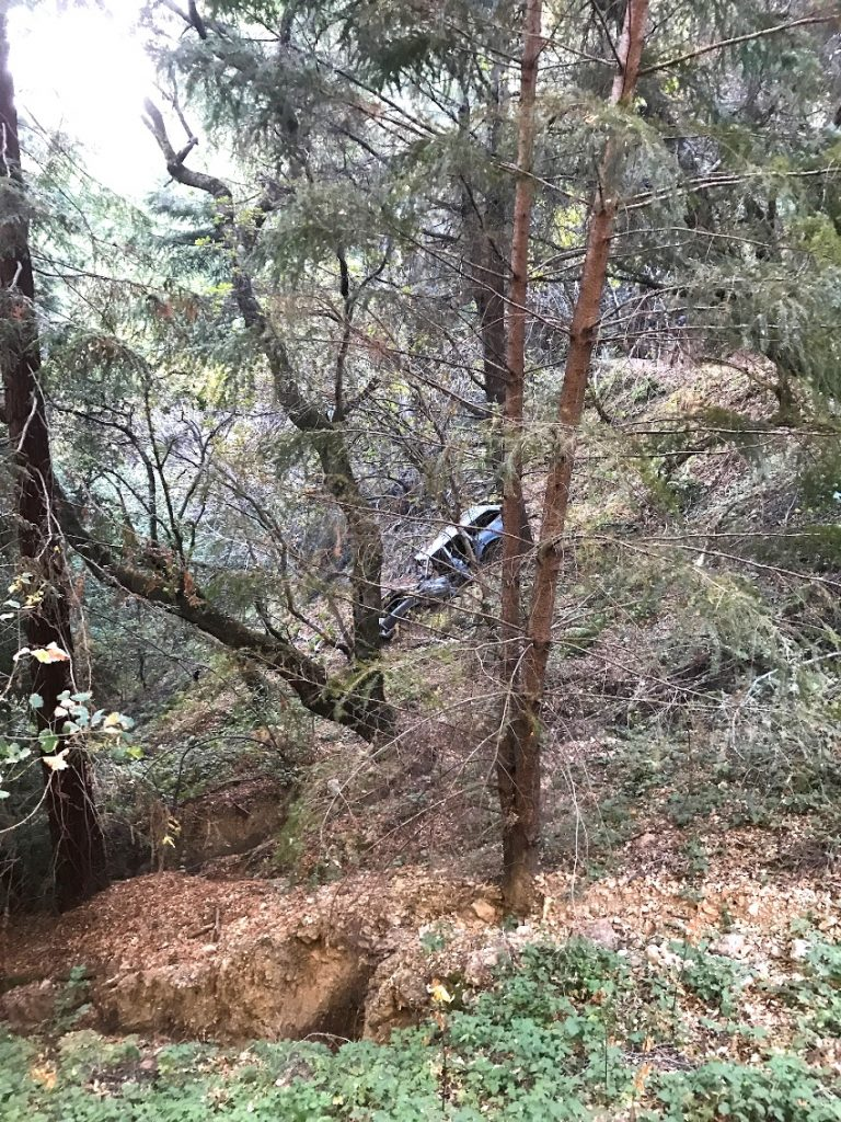 A car that crashed into the canyon along the Skyline to the Sea Trail