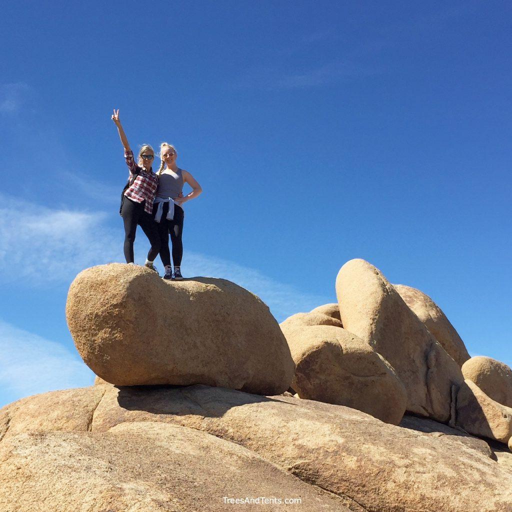 Climbing on rocks along the trail to Mastodon Peak in Joshua Tree.