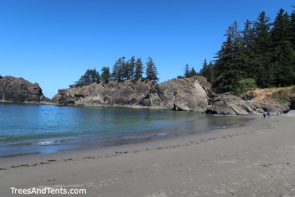 Walking along Oregon's Secret Beach after a short hike and a brief rock scramble.