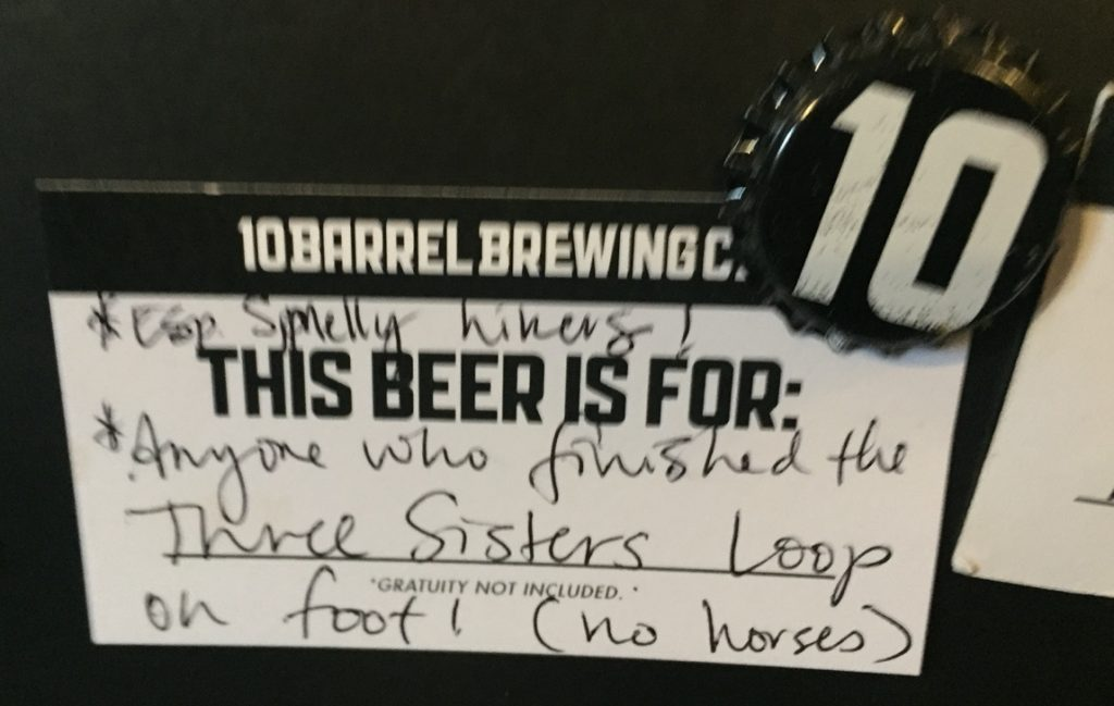 A blurry photo of our 10 Barrel beer gift for future Three Sisters Loop hikers