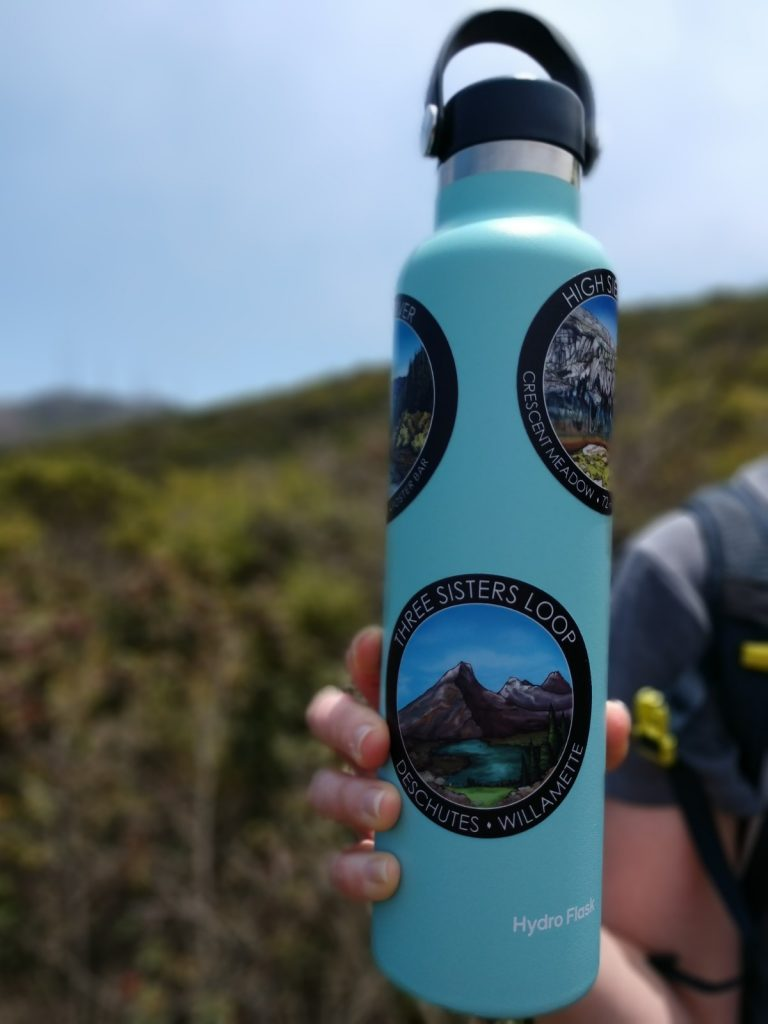 Three Sisters Wilderness hiking sticker on a 24 ounce water bottle