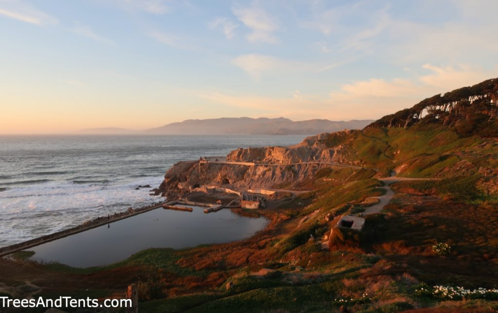 Looking down on the Sutro Baths ruins from a viewpoint at golden hour