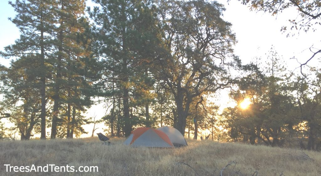 Watching the sunrise from camp while backpacking Henry Coe State Park.