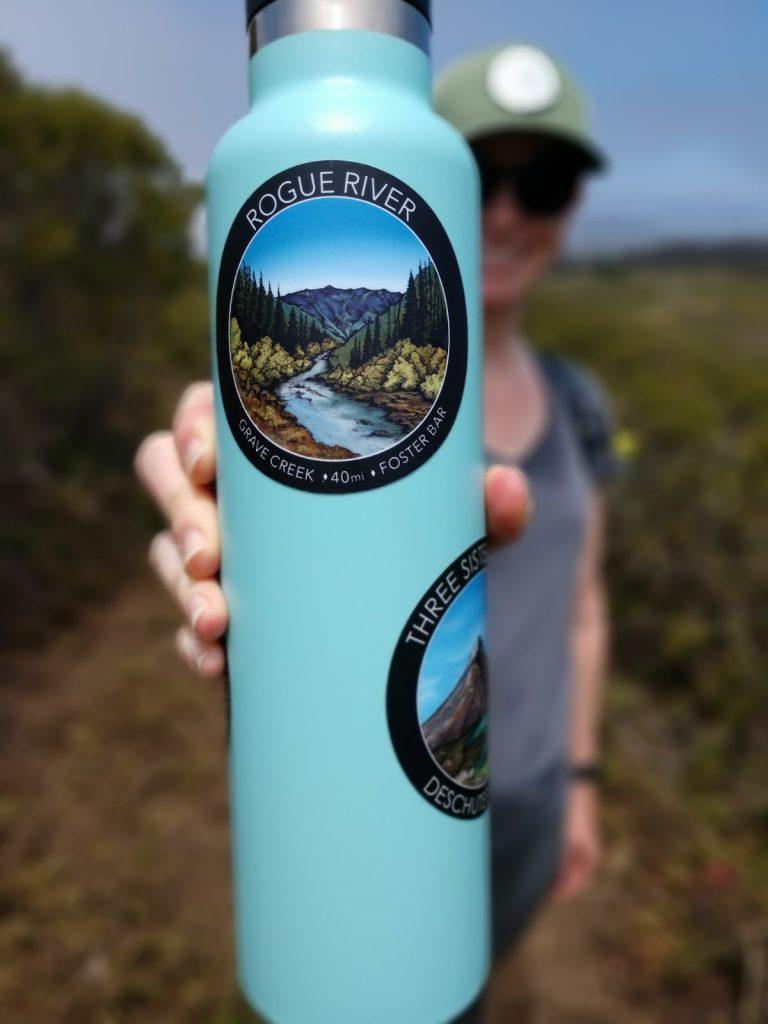Rogue River sticker on a 24 ounce water bottle